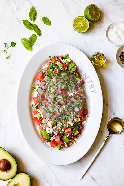 Watermelon Feta Salad on white marble background