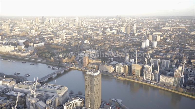 Aerial footage of the River Thames as it cuts a path between Westminster and Lambeth