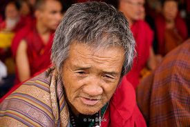A local man at a blessing by the Chief Abbot of the Central Monastic Body of Bhutan in Paro, Bhutan.