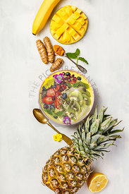 Mango banana pineapple turmeric smoothie bowl