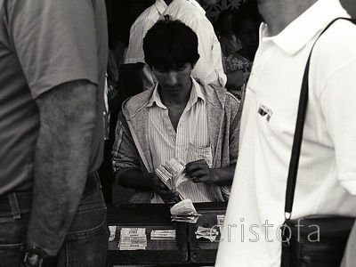 a lotto ticket seller sorts tickets in Panama City