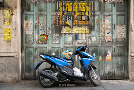A bike against tattered walls in Chinatown in Bangkok, Thailand.