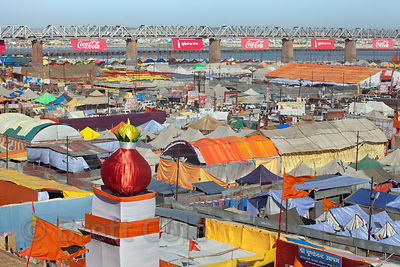 Brightly colored tents and Coca-Cola banners ar the 2013 Kumbh Mela, Allahabad, India.