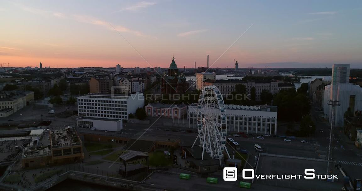 Sunset Cityscape, Aerial View Around the Helsinki Skywheel Ferris Wheel, Revealing the Market Square and South Harbour, on a Sunny Summer Evening Dusk, in Helsinki, Uusimaa, Finland