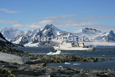 Polar cruise ship Akademic Ioffe from rocky Stonington Island in Marguerite Bay, West Graham Land, Antarctica