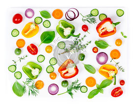 Composition of Fresh organic vegetables (pepper, onion, cucumber, carrot, tomatoe), herbs, olive oil and vinegar  isolated on white background, top view