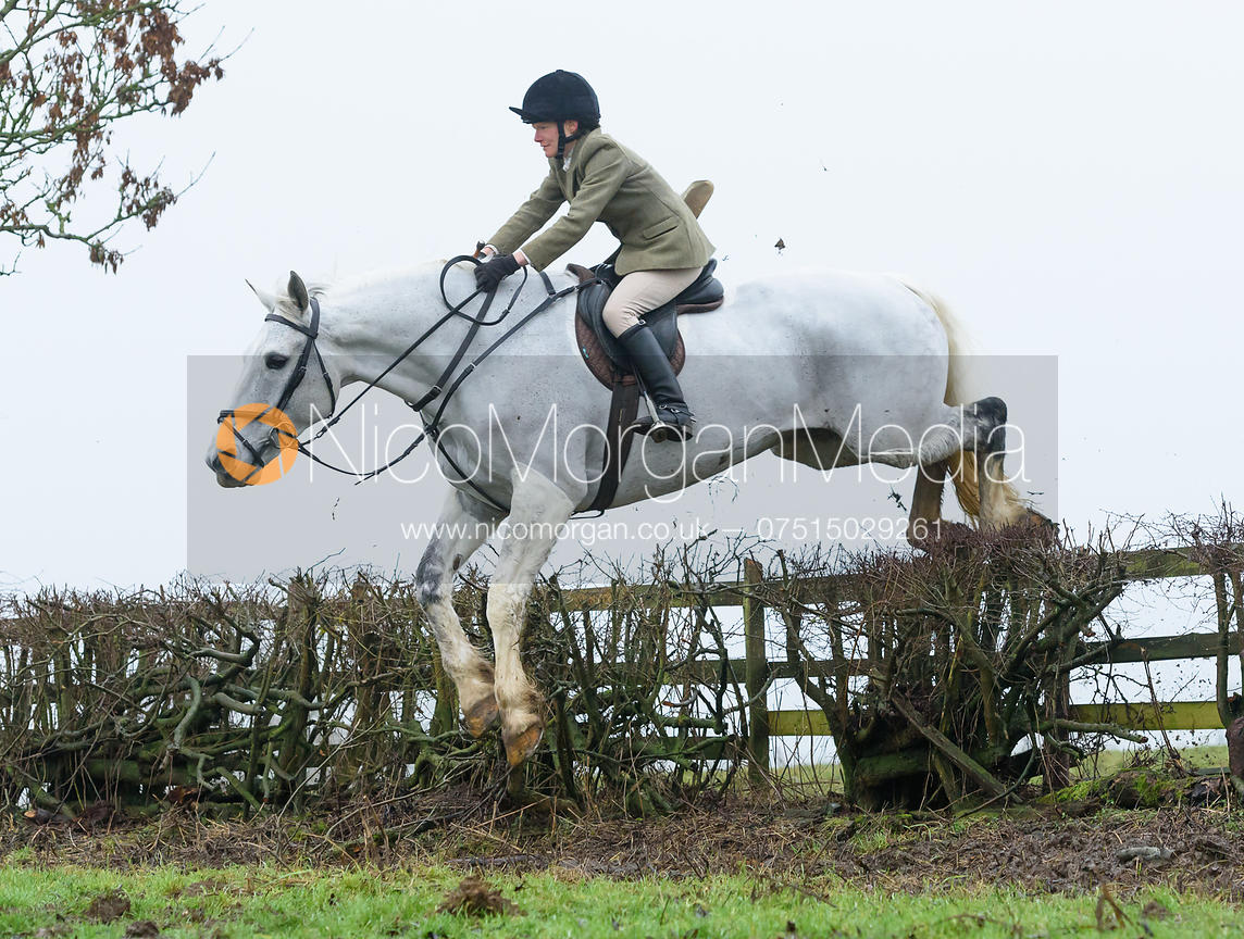 Alice Robb jumping a hedge above Withcote