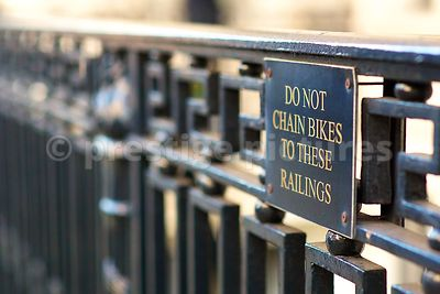 No Bikes Sign on Wrought Iron Black Railings