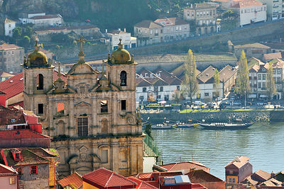 The old districts of Oporto overlooking the Douro river, a Unesco World Heritage Site. Port wine cellars on the other side of the river, in Vila Nova de Gaia.  Portugal