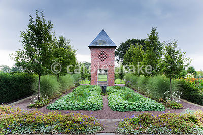 Dovecote built in 2007 to reflect the barn, with planting including Pyrus calleryana 'Chanticleer', Miscanthus sinensis 'Morning Light', Verbena bonariensis and Alchemilla mollis. Rhodds Farm, Kington, Herefordshire, UK