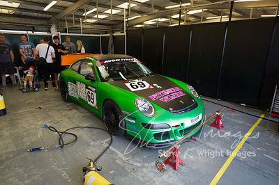 APO Motorsport's Porsche 911 GT4 in the pit lane, pre-race, at the Silverstone 500 - the third round of the British GT Championship 2014 - 1st June 2014