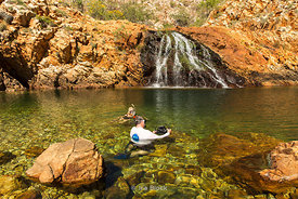 Tourists at Crocodile Creek in the Kimberley of Australia.