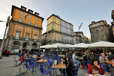 Outdoor Cafe on Ribeira District, overlooking the Douro river, a Unesco World Heritage Site. Oporto, Portugal