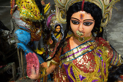 Durga idols are recovered from the Hooghly River after being immersed during the Durga Puja idols, Babughat, Kolkata, India. The idols are recovered to avoid polluting the river. They're made from straw and river clay, but the paints are not eco-friendly.
