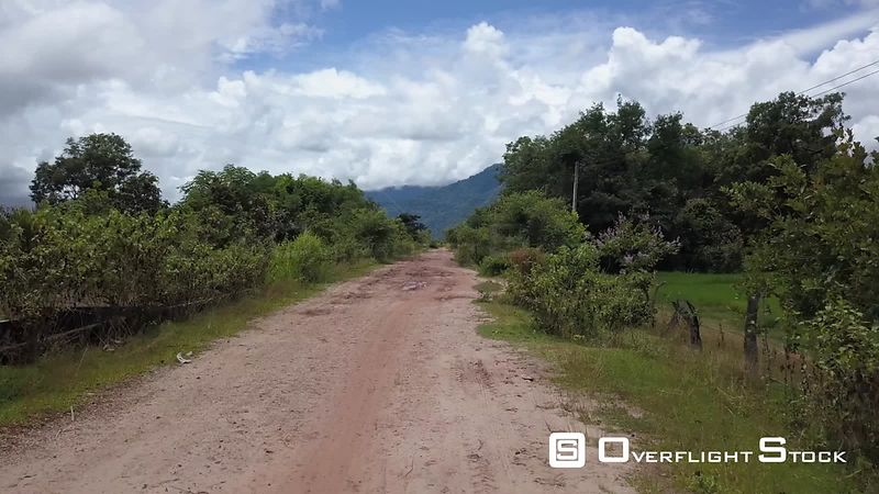 Aerial view of Road in Village Champassak on Mekong, filmed by drone, Laos