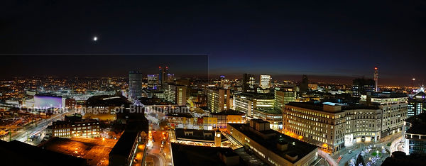 Aerial view of Birmingham, UK at night. Panoramic cityscape.