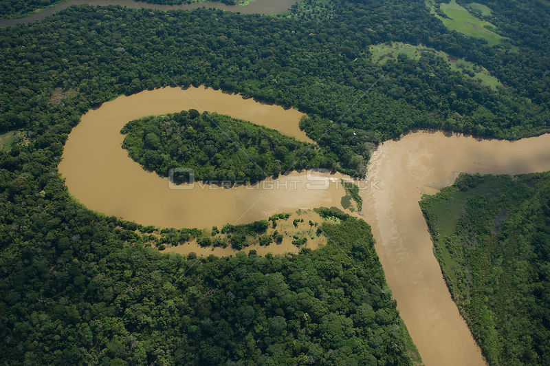 "Aerial view of river meander and formation of ox-bow lake, in Amazon ""várzea"" Rainforest during the great 2008 flood, Northern Santa Cruz Department near the border with Beni Department, Eastern Bolivia."