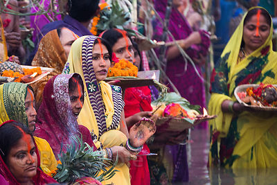Hindu devotees await sunrise on the Ganges River during Chhath Puja, Varanasi, India. Chhath Puja is a devotion to the Sun God Surya in which people gather at sunset and then on the following sunrise and offer prayers.