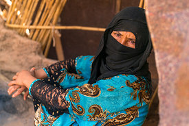 Portrait of a woman in the Erg Chebbi sand dunes in Sahara Desert, Morocco