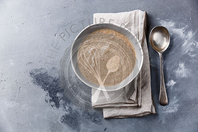 Mushroom soup on concrete background copy space