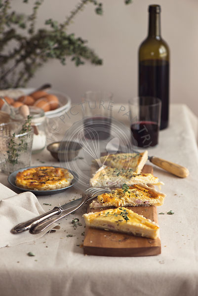 Quiche lorraine in a rustic table setting