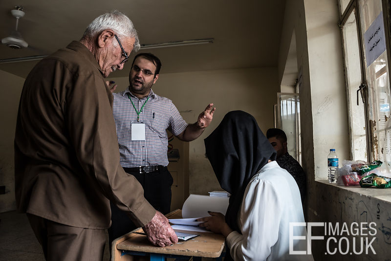 A polling station employee remonstrates with a prospective voter in the Kurdish Independence Referendum in Iraqi Kurdistan because his name is not on the polling station list. Erbil, 25th September 2017