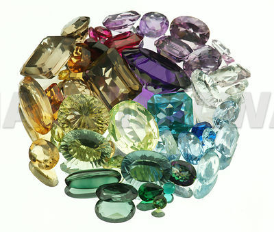 Large variety of Gemstones on mirror, Studio shot..Amethyst, Lemonquartz, Topaz, Aquamarine, Citrine,Smokey quarts, Ruby, Sapphire...