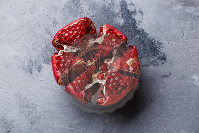 Ripe Pomegranate on gray concrete background