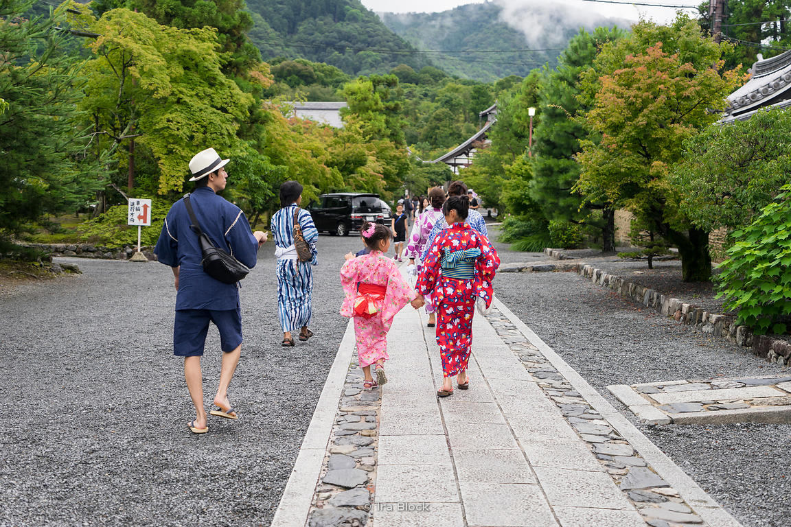 People walking with yukata, a Japanese garment, a casual summer kimono in Arashiyama, Kyoto.