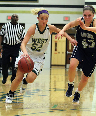 The #1 ranked Iowa City West varsity girls basketball team defeated visiting Cedar Rapids Xavier 52-37 on Thursday, January 26th, 2012. The Women of Troy improve to a perfect 14-0 on the year.