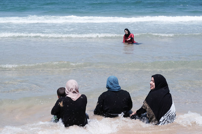 Palestinians celebrate the end of ramadan at Tel-aviv beach,for some of them is the first time at the sea