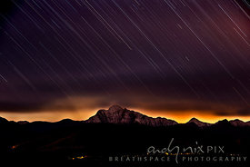 Snow on Formosa Peak with star trails