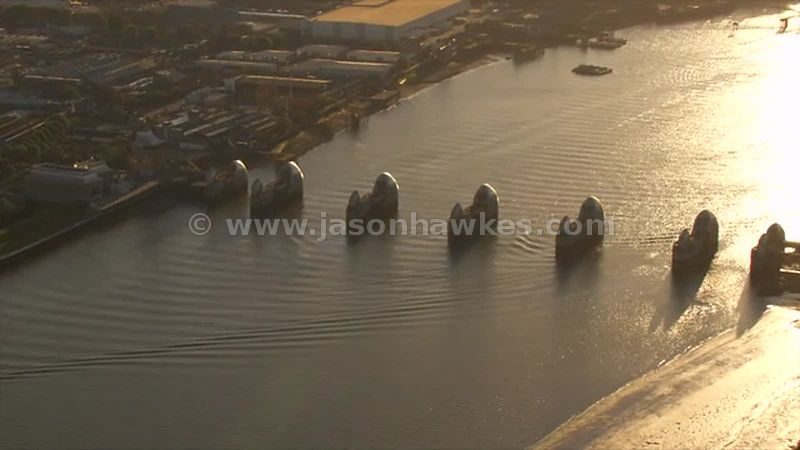 Aerial footage of the Thames Barrier at sunset, London