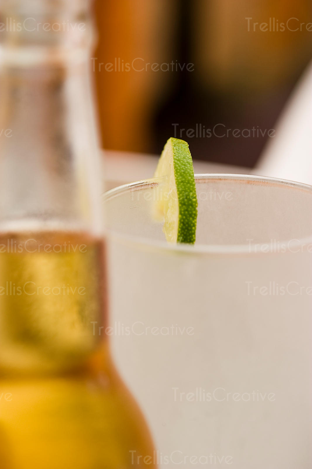 Cold beer and frosty glass with lime slice