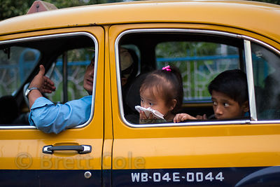 A girl shields her mouth from traffic fumes while riding in a taxi in Bhawanipur, Kolkata, India. Air pollution in Kolkata is horrible, said to equal smoking up to two packs a day during the worst times of the year. I have had multiple respiratory infection while working there.