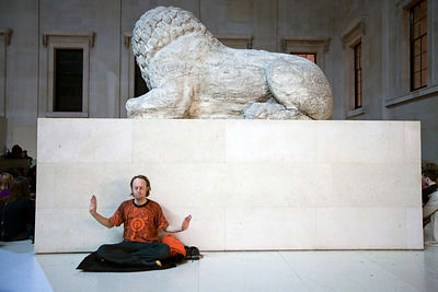 UK - London - A man performs qi gong meditation as part of a meditation flash mob in the Great Court of the British Museum