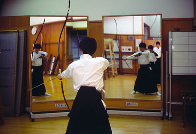 Japan - Kyoto - A Kyuodo practitioner practices in fron tof a mirror.