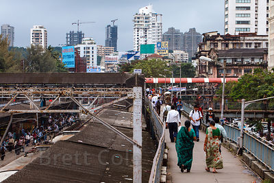 "With 20 million people the roads of Mumbai, India are choked with traffic day and night. In a futile attempt to relieve congestion at key locations, the city constructed several dozen elevated ""skywalks"" to guide pedestrains over congested areas like train stations."