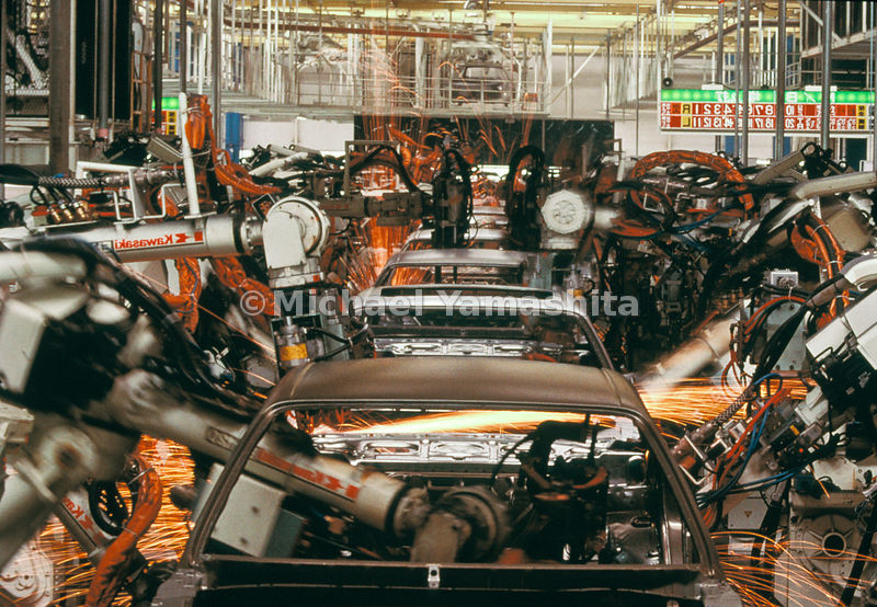 Robotic arms that can stop on a yen weld bodies of the Mark II hardtop made only for domestic sale, at Toyota's new plant in Fukuoka Prefecture.