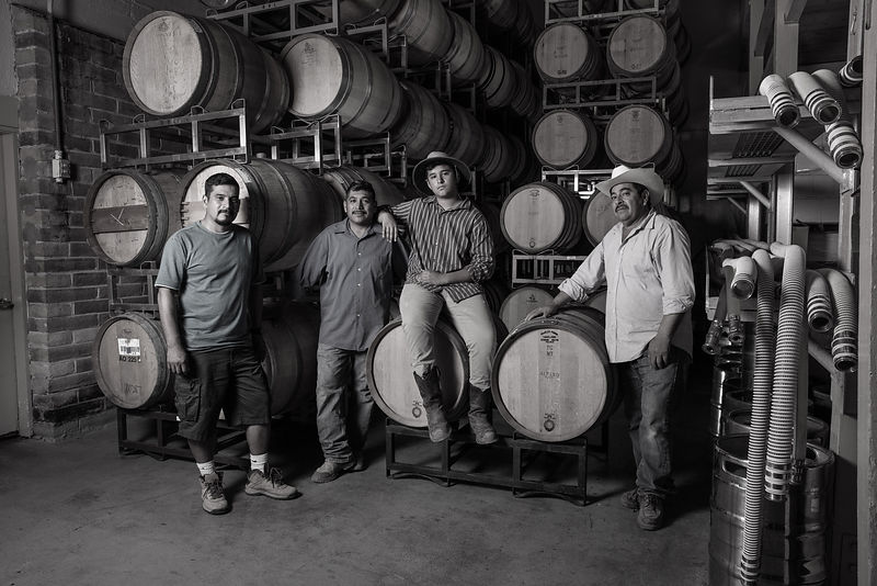 Three generations of a Latino winemaking family. Photographed for Worth Magazine by Jason Tinacci