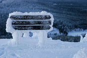 Hiking trail signs under snow