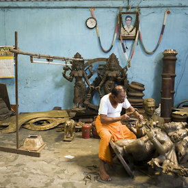 Master craftsman Pranava Stapathy works on a large statue of Hanuman