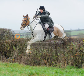 Martin Reason jumping a hedge behind Waterloo Lodge