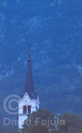 Bell tower of the Church of Saint Ulrich (Sveti Urh) at dusk after a Summer storm