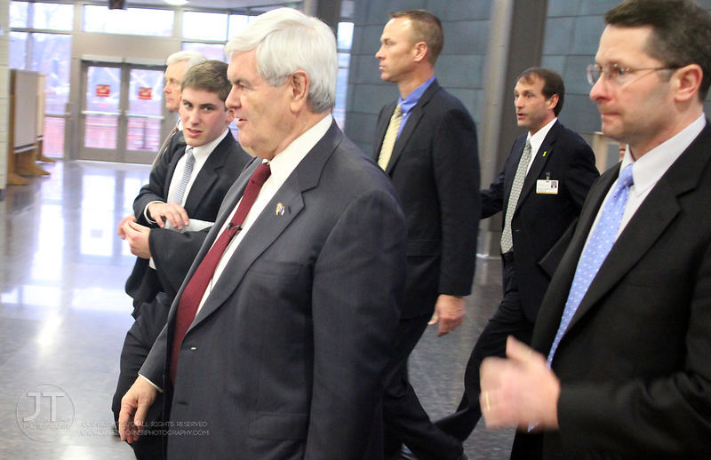Republican Presidential candidate Newt Gingrich walks with his advisors and security staff in the Medical Education and Research Facility on the University of Iowa's campus n Wednesday.