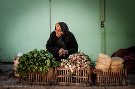 Woman selling vegetables in Aswan.
