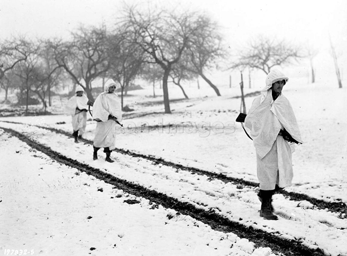 American soldiers trudge through snow in Luxembourg