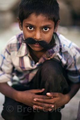 A boy with a fake mustache in Jaipur, Rajasthan, India