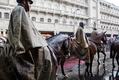 Horse mounted police officers patrol the busy Newmarket area of Kolkata, India