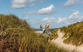 Danish girl playing in the dunes in Thy 9